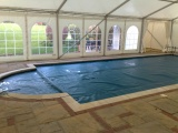 Frame marquee over pool